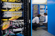 IT technicians checking network server