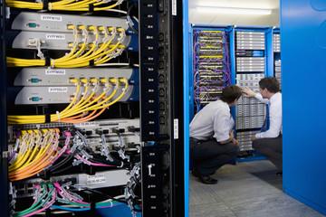 IT technicians checking network server