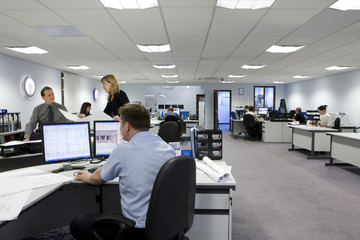 CAD designers and architects working in office