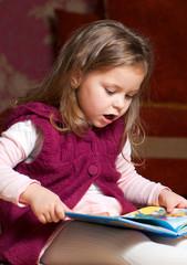 sweet  little girl reading book