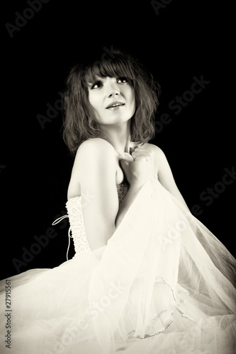 Pretty woman posing on a black background