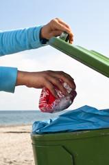 throwing away garbage at the beach