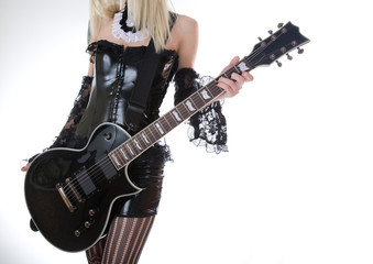 Close-up of girl with black electro guitar