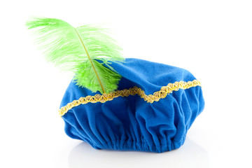 blue hat with green feather of Zwarte Piet over white background