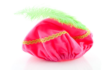 pink hat with green feather of Zwarte Piet over white background