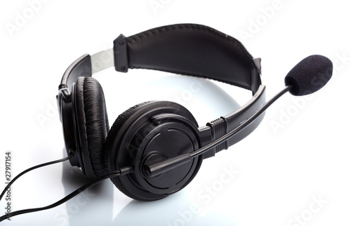 Headphones with a microphone over white background