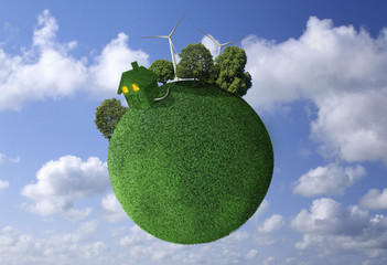 Grass covered globe in sky with house and wind turbines