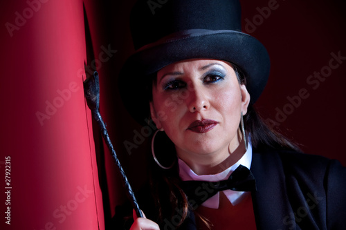 Woman with whip wearing a top hat
