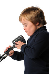 Boy With Down syndrome Singing into Microphone