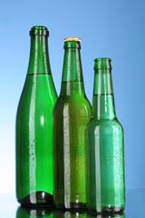 Bottles of beer on blue background