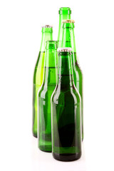Many bottles of beer isolated on white