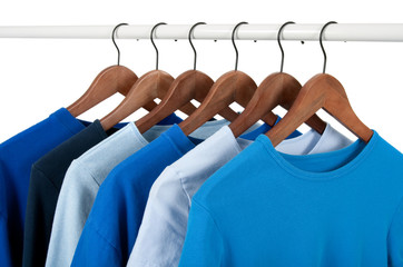 Casual shirts on hangers, different tones of blue