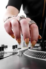 Hands of female DJ puting needle on record