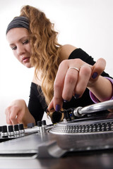 Female dj puts needle on vinyl record