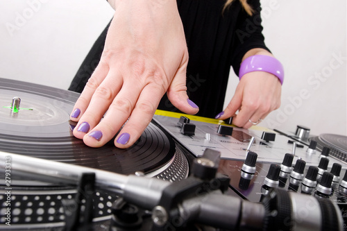 Hands of female hip-hop DJ scratching