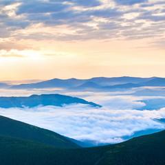 Summer cloudy sunrise in mountain