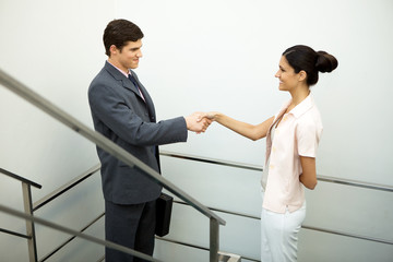 Handshaking on stairs