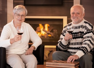 Happy senior couple having wine