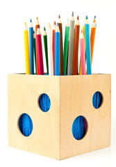 Pencils in holder over white