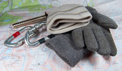 winter sport and climbing gear on map background