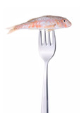 Red mullet on fork isolated on white .