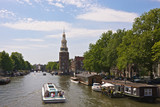 Amsterdam, Netherlands, Montelbaan Tower and canal cruise boat