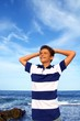 boy teenager hands in head relaxed in blue ocean