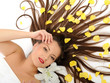 Beautiful spa woman with long healthy hair and bright make-up re