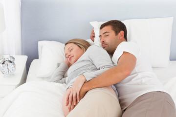 Cute couple of future parents doing a nap