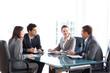 Leinwanddruck Bild - Businessmen and businesswomen talking during a meeting