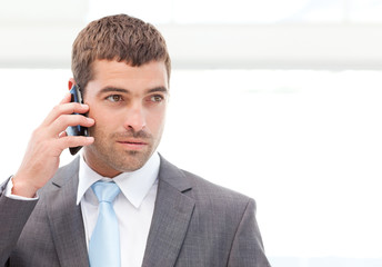 Handsome hispanic businessman on the phone