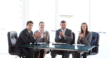 Cheerful businessteam applauding during a presentation
