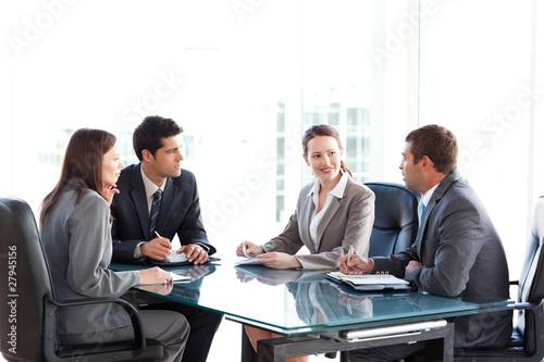 Leinwanddruck Bild Businessmen and businesswomen talking during a meeting