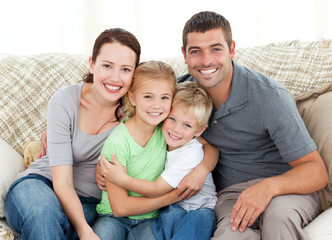 Happy family sitting on the sofa