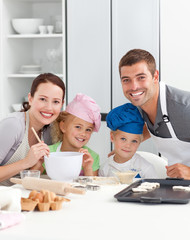 Parents and childrnbaking together in the kitchen