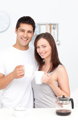 Portrait of a couple drinking coffee during breakfast