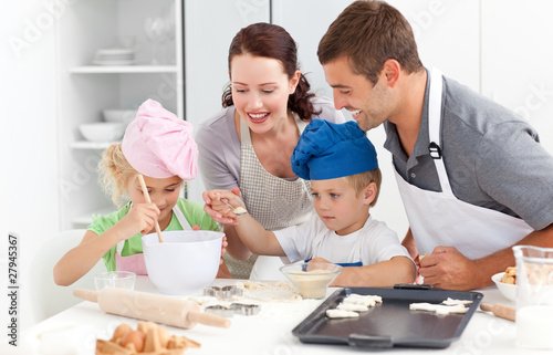 Happy family cooking a cream together in the kitchen