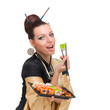 Young woman wearing a traditional dress eating sushi, isolated