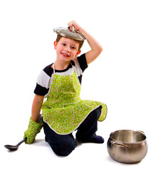 Smiling boy with cooking accessories, isolated