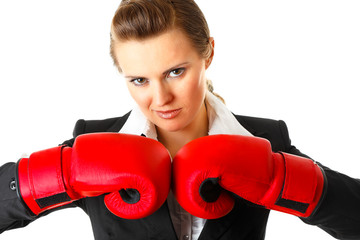 Confident modern business woman with boxing gloves.