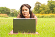 Young lady with laptop in park