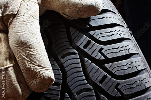 profile of a snow tire and glove