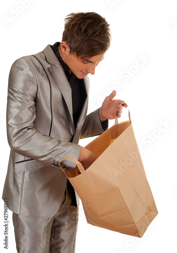 man keeping recycled ecological paper bag