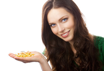 Portrait of woman showing Omega 3 fish oil capsules, isolated