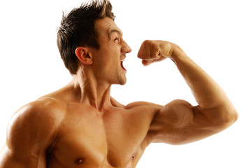 An attractive strong man posing with fist