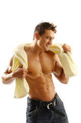 An attractive strong man posing with towel