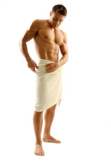 An attractive strong man wrapped in towel