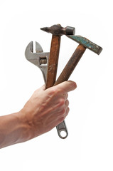wrench and 2 hammers in hand
