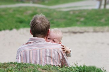 Crying child in fathers arm
