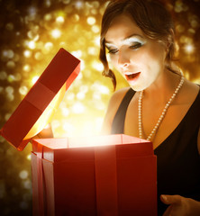 Beautiful Girl Getting Christmas or New Year Gift
